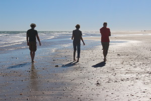 Family walks on the beach