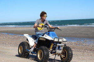 The Awesome Son driving the quad